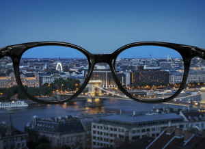 Clear vision through glasses over night city landscape